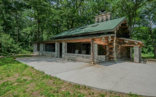 log home on acreage with lake frontage